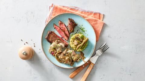 Biefstuk met champignonsaus en bloemkooltartaar met kaas