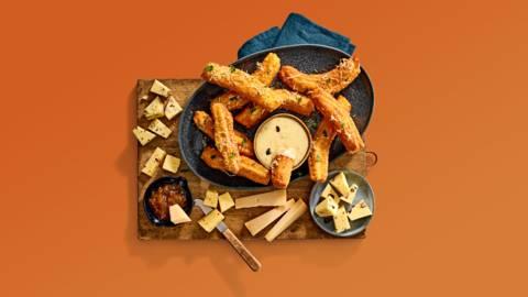 Hartige churros met pompoen-wortelkaasdip