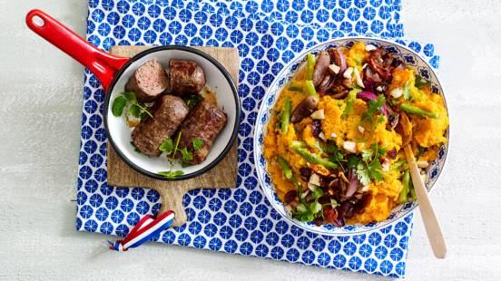 Zoete aardappelstamppot met pompoen, sperziebonen en rundervinken