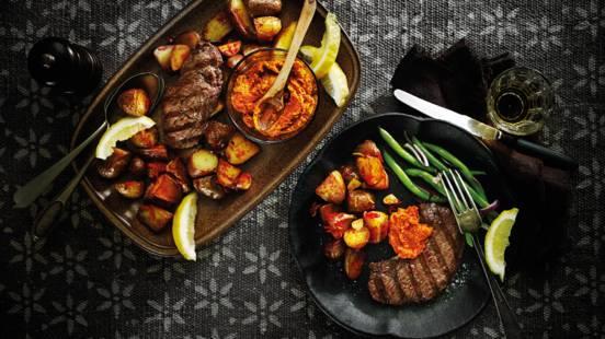 Gegrilde biefstuk met Romesco saus en patatas brava