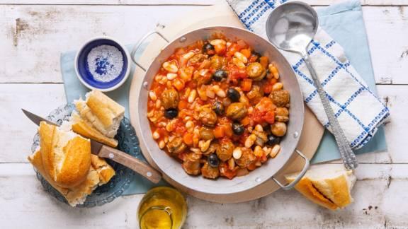 Griekse braadworst met reuze bonen