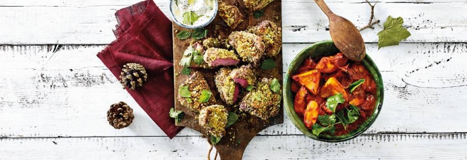 Lamskotelet met notenkruidenkorstje met Arabische groentestoof van bio pompoen, wortel, ui, tomaat en yoghurt munt-saus