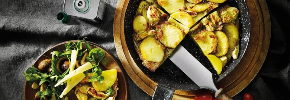 Tortilla met artisjok, Manchego en salade van gebakken campignons
