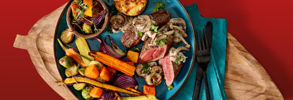Reefilet met paddenstoelensaus met mini gratins en geroosterde herfstgroenten uit de oven