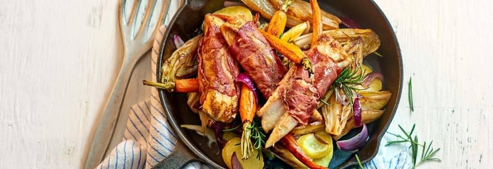 Pangasiusfilet met Coppa di Parma, witlof een aardappelschijfjes in de oven